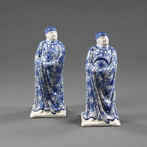 A pair of blue and white figures
