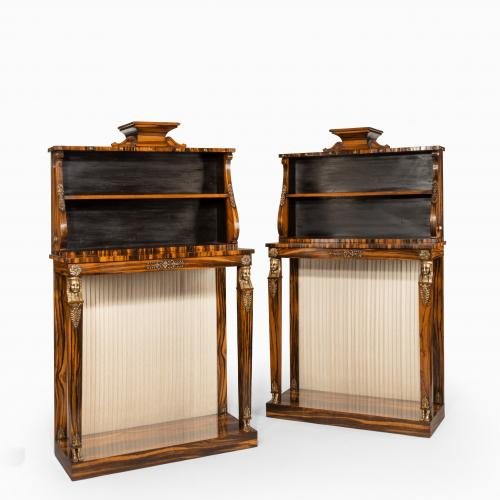 A pair of high Regency coromandel and ormolu bookcase console tables
