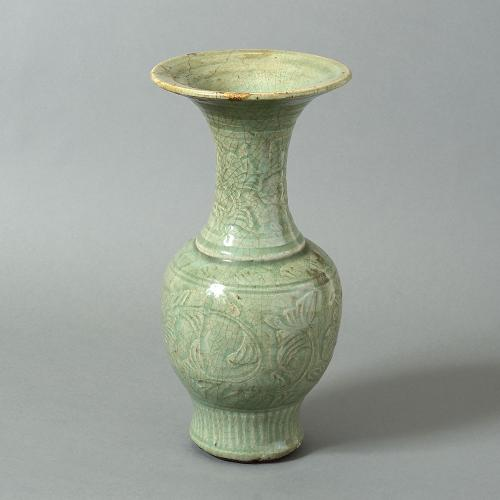 A 15th century Ming period celadon baluster vase