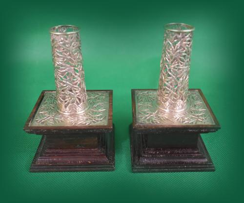 Pair of Chinese silver candle stick holders