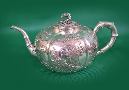 Set of Chinese silver teapot, sugar pot and milk jug