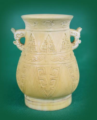 Chinese Ivory small vase decorated with geometric design, dragon handles