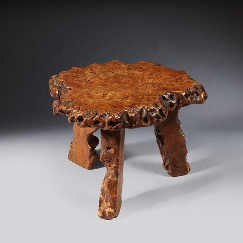 A small sectional tree trunk stool
