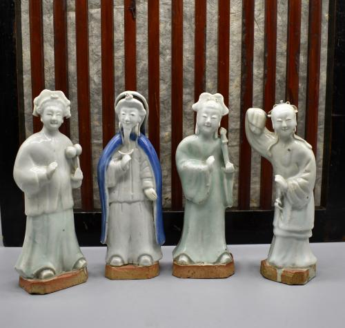 A group of biscuit porcelain figures