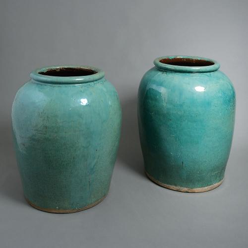 A massive pair of turquoise planters