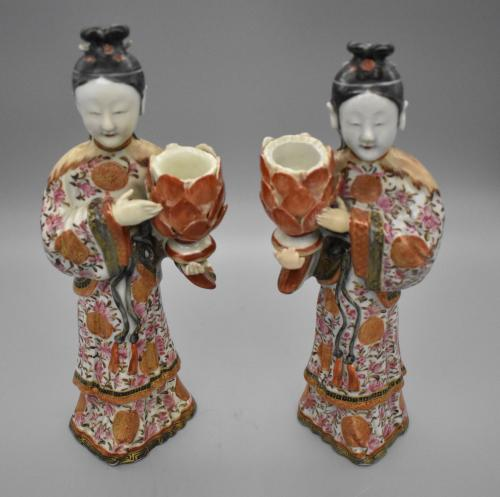 A pair of famille-rose figures candle holders
