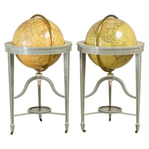 A pair of 21′ contemporary library floor-standing globes