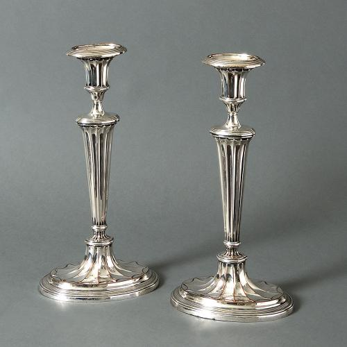 A pair of Sheffield plate candlesticks