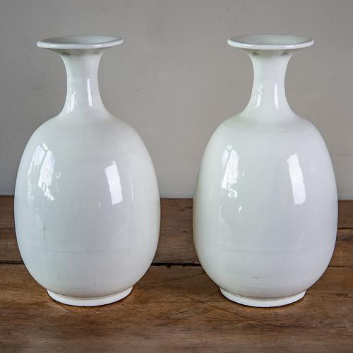 A pair of white-glazed porcelain vases
