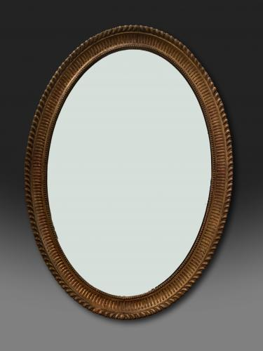 George III oval Adam giltwood mirror with original gilding