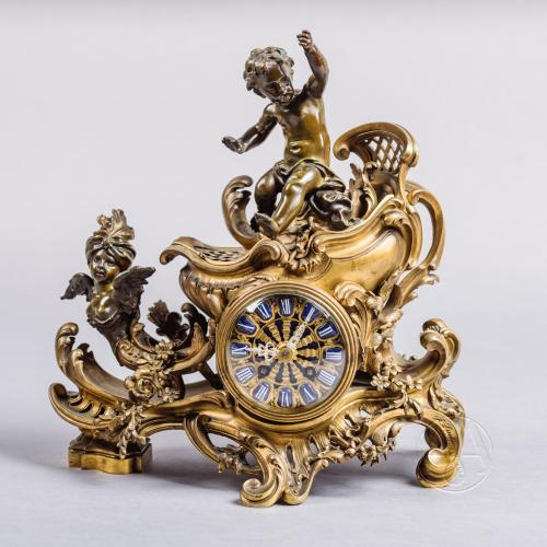 A Rare Gilt and Patinated Bronze 'Chariot' Mantel Clock By François Linke