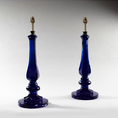 A pair of dark blue baluster lamps with round bases