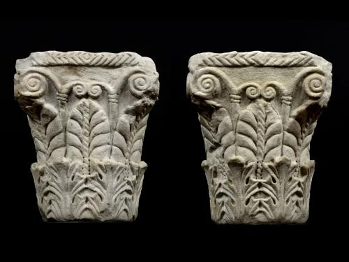 A Pair of pseudo Corinthian Capitals with acanthus foliage and palmettes