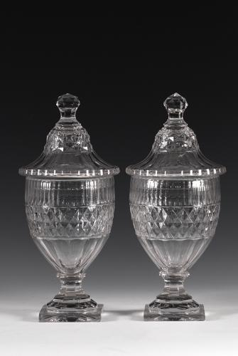 A pair of covered urns