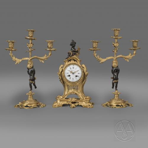 A Fine Louis XV Style Gilt and Patinated Bronze Figural Clock Garniture by Maison Baguès. French, Circa 1870.