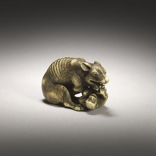 Ivory netsuke of a wolf and monkey by Tomotada (Active 1760-1780)