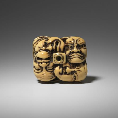 Celebrated Large Walrus Ivory Netsuke of Masks by Moriharu