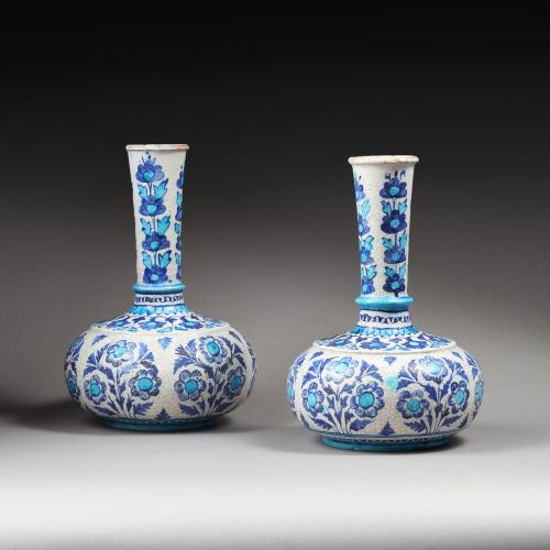 A near pair of Indian pottery vases