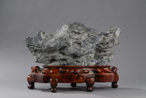 A massive grey lingbi scholar's rock, Chinese, Qing dynasty, 18th century.