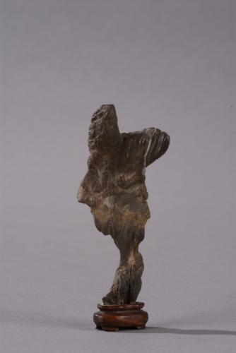 A small light brown ying limestone rock in the form of a miniature dancing Tang lady, Chinese, Qing dynasty, 18th century