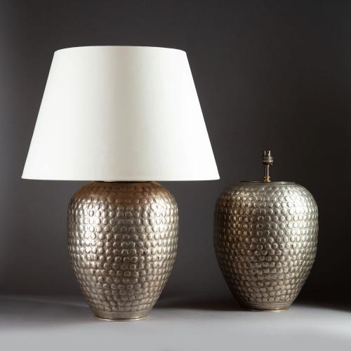 A Pair of Large Silvered Punched Metal Lamps