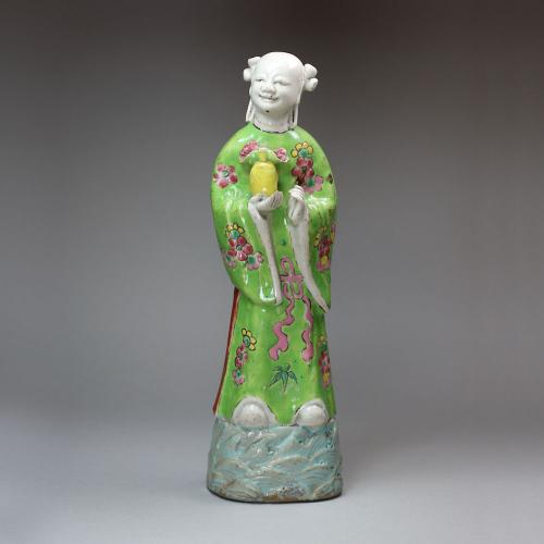 Chinese famille rose biscuit figure of the immortal Lan Caihe, Qianlong (1736-95)