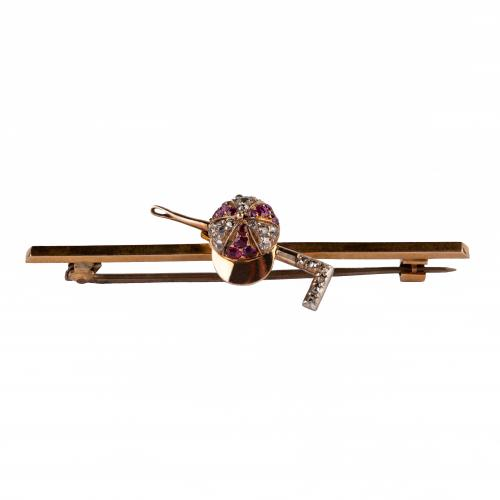 Equestrian Bar Brooch of Jockeys Cap & Crop set with Rubies and Diamonds, English circa 1870.