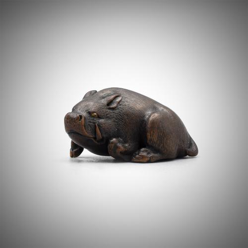 Wood Netsuke of a Resting Boar by Hokudo Itsumin (Active 1830-70)