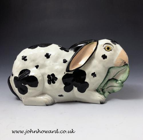 Staffordshire pottery figure of a rabbit nibbling on leaves mid 19th century