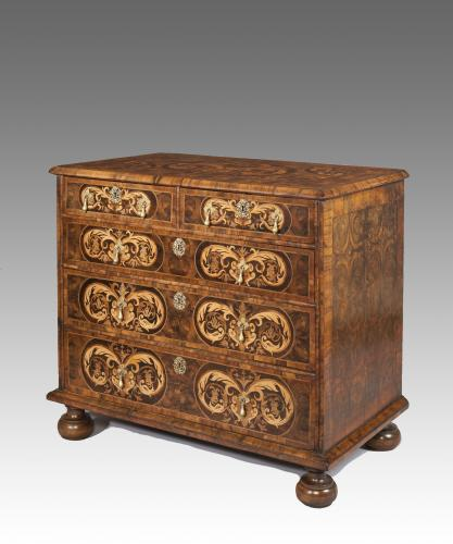 A William and Mary oyster veneered chest of drawers with marquetry inlay.