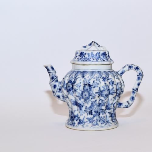 Chinese porcelain blue and white baluster-shaped teapot and matching cover of bamboo form painted on the moulded body with birds, flowers and insects, all below a raised band of pendant leaves, 13.5cm high, Kangxi circa 1700. Perfect condition
