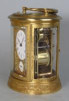 Drocourt An engraved oval carriage clock side
