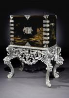 A Japanese Lacquer Cabinet on Silvered Stand
